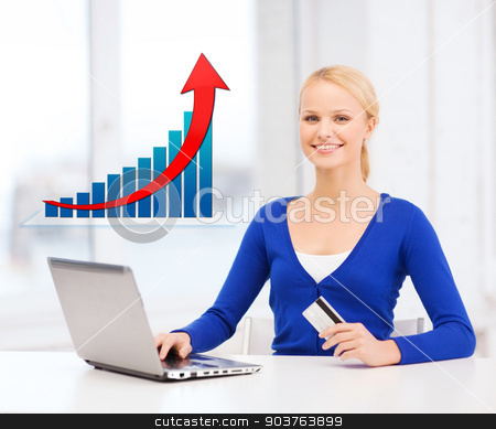 smiling woman with laptop computer and credit card stock photo, online shopping, finances, people and technology concept - smiling young woman with laptop computer, credit card and growth chart by Syda Productions