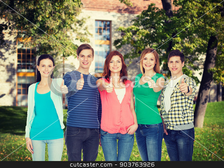 group of smiling students showing thumbs up stock photo, education and people concept - group of smiling students standing and showing thumbs up by Syda Productions