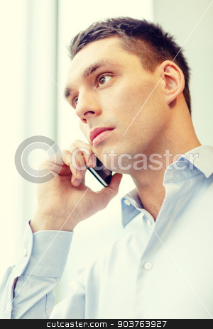 serious businessman with smartphone stock photo, business, technology and office concept - serious businessman with smartphone by Syda Productions