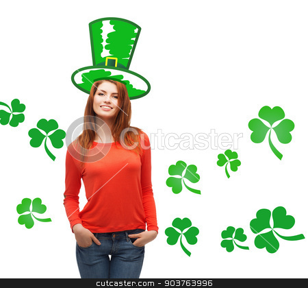 smiling teen girl in green top hat with shamrock stock photo, gestures, holidays, st. patricks day and people concept - happy teenager in green top hat over white background with shamrock or clover by Syda Productions