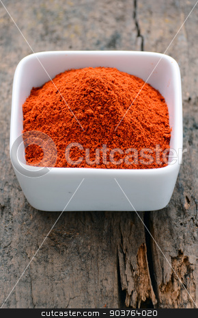 Powdered red pepper stock photo, Powdered red pepper in a white bowl by sutike