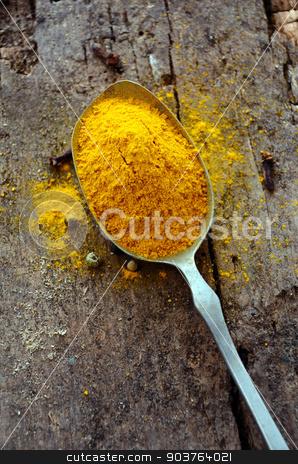 Ground turmeric stock photo, Ground turmeric in a spoon  by sutike