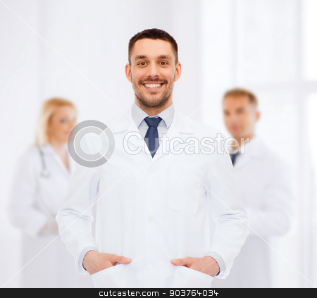 smiling male doctor in white coat stock photo, healthcare, profession and medicine concept - smiling male doctor in white coat over white background by Syda Productions