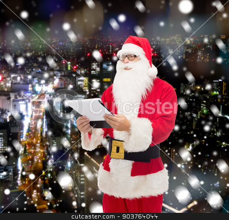 man in costume of santa claus with notepad stock photo, christmas, holidays and people concept - man in costume of santa claus with notepad over snowy night city background by Syda Productions