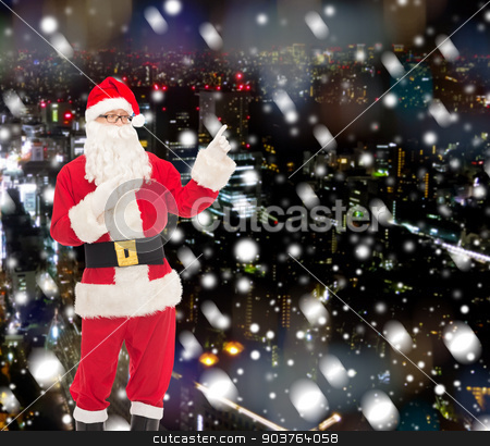man in costume of santa claus stock photo, christmas, holidays, gesture and people concept - man in costume of santa claus pointing fingers over snowy night city background by Syda Productions
