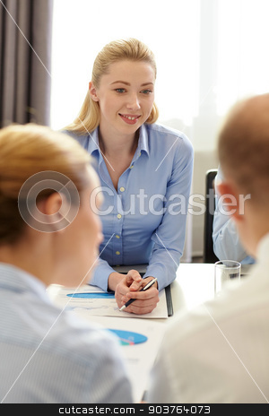 business people with papers meeting in office stock photo, business, people and teamwork concept - smiling business team with papers meeting in office by Syda Productions