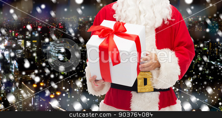 man in costume of santa claus with gift box stock photo, christmas, holidays and people concept - close up of santa claus with gift box over snowy night city background by Syda Productions