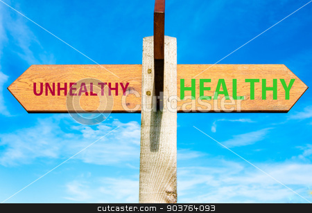 Wooden signpost with two opposite arrows over clear blue sky, Healthy versus Unhealthy messages, Healthy Lifestyle conceptual image stock photo, Wooden signpost with two opposite arrows over clear blue sky, Healthy versus Unhealthy messages, Healthy Lifestyle conceptual image by Constantin Stanciu