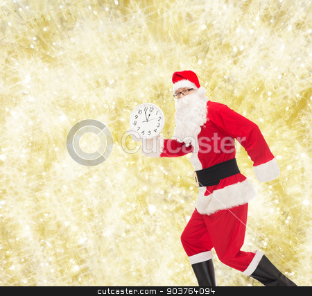 man in costume of santa claus with clock stock photo, christmas, holidays and people concept - man in costume of santa claus running with clock showing twelve over yellow lights background by Syda Productions