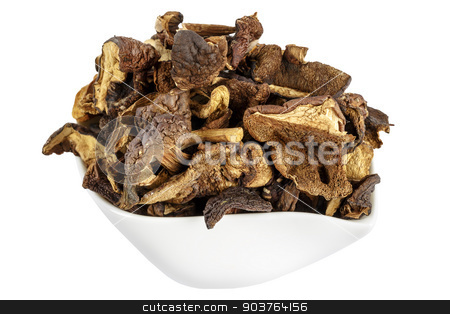 Wild and dried mushrooms placed in a dish stock photo, Shown up close serving of wild and dried mushrooms placed in a dish by marekusz