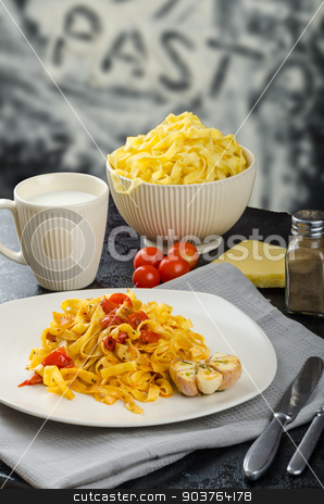 Homemade tagliatelle with garlic and cherry tomatoes stock photo, Homemade tagliatelle with cherry tomatoes and roasted garlic bio by Peteer