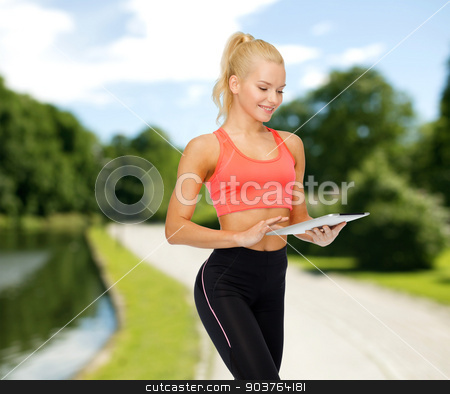 smiling sporty woman with tablet pc computer stock photo, sport, exercise, technology, internet and healthcare concept - smiling sporty woman with tablet pc computer by Syda Productions
