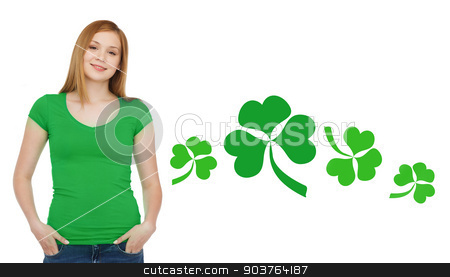 smiling teen girl in green t-shirt with shamrock stock photo, gestures, holidays, st. patricks day and people concept - happy teenager in blank green t-shirt over white background with shamrock or clover by Syda Productions