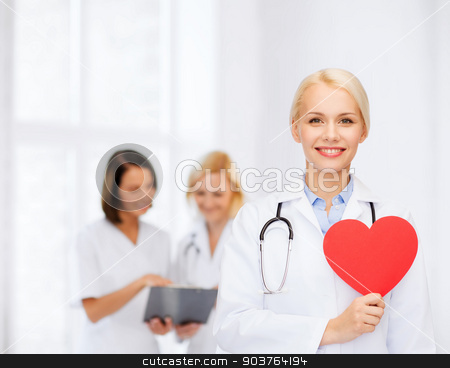 smiling female doctor with heart and stethoscope stock photo, healthcare and medicine concept - smiling female doctor with heart and stethoscope by Syda Productions