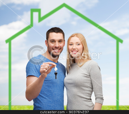 smiling couple holding key over green house stock photo, love, home, people and family concept - smiling couple holding house key over green house and blue sky with grass background by Syda Productions