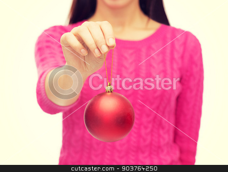 close up of woman in sweater with christmas ball stock photo, christmas, decoration, holidays and people concept - close up of woman in pink sweater holding christmas ball by Syda Productions