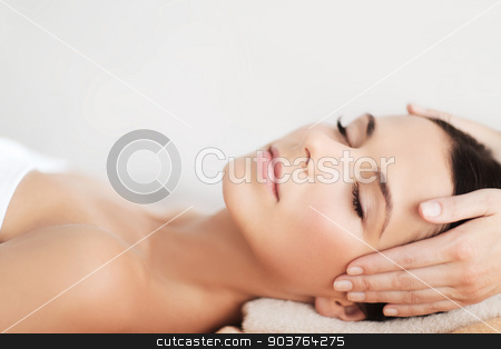 beautiful woman in spa salon having facial stock photo, spa, resort, beauty and health concept - beautiful woman in spa salon getting face treatment by Syda Productions