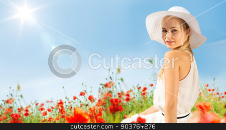 smiling young woman in straw hat on poppy field stock photo, happiness, nature, summer, vacation and people concept - smiling young woman with closed eyes wearing straw hat on poppy field by Syda Productions