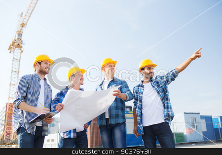 group of builders with tablet pc and blueprint stock photo, business, building, teamwork and people concept - group of smiling builders in hardhats with clipboard and blueprint outdoors by Syda Productions