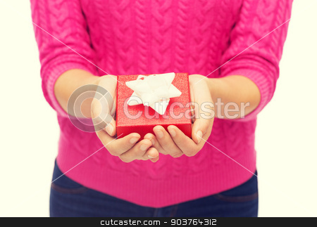 close up of woman in pink sweater holding gift box stock photo, christmas, holidays and people concept - close up of woman in pink sweater holding gift box by Syda Productions