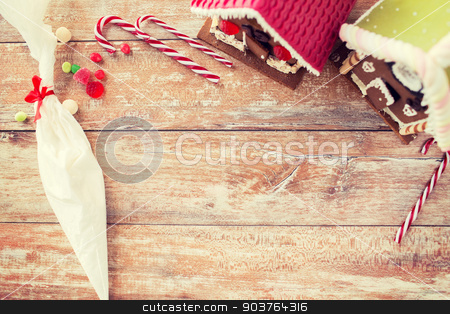 closeup of beautiful gingerbread houses at home stock photo, holidays, christmas, baking and sweets concept - closeup of beautiful gingerbread houses at home by Syda Productions