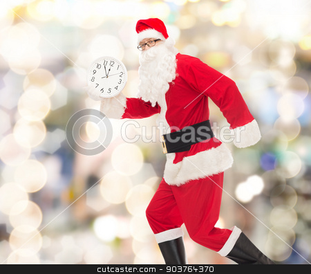 man in costume of santa claus with clock stock photo, christmas, holidays and people concept - man in costume of santa claus running with clock showing twelve over lights background by Syda Productions