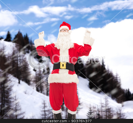 man in costume of santa claus stock photo, christmas, holidays and people concept - man in costume of santa claus having fun over snowy mountains background by Syda Productions