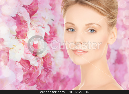 beautiful young woman face stock photo, beauty, people and health concept - beautiful young woman face over pink floral background by Syda Productions