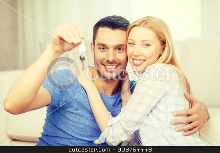 smiling couple holding keys at home stock photo, real estate, family and couple concept - smiling couple holding keys at home by Syda Productions