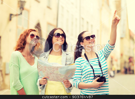 smiling teenage girls with map and camera stock photo, tourism, travel, leisure, holidays and friendship concept - smiling teenage girls with map and camera outdoors by Syda Productions