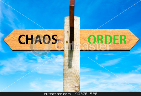 Wooden signpost with two opposite arrows over clear blue sky, Chaos versus Order messages stock photo, Wooden signpost with two opposite arrows over clear blue sky, Chaos versus Order messages by Constantin Stanciu