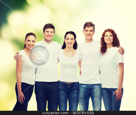 group of smiling teenagers in white blank t-shirts stock photo, advertising, ecology, nature, friendship and people concept - group of smiling teenagers in white blank t-shirts over green background by Syda Productions