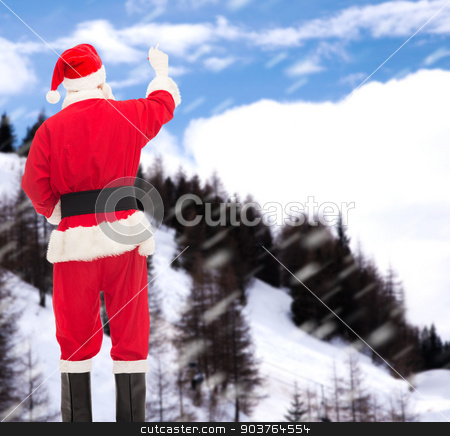 man in costume of santa claus writing something stock photo, christmas, holidays and people concept - man in costume of santa claus writing something from back over snowy mountains background by Syda Productions