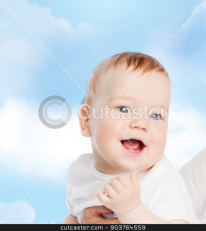 close up of mother holding smiling baby stock photo, family, child and parenthood concept - close up of mother holding smiling baby by Syda Productions