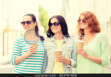 smiling teenage girls with on street stock photo, vacation, weekend, drinks and friendship concept - smiling teenage girls with coffee cups on street by Syda Productions