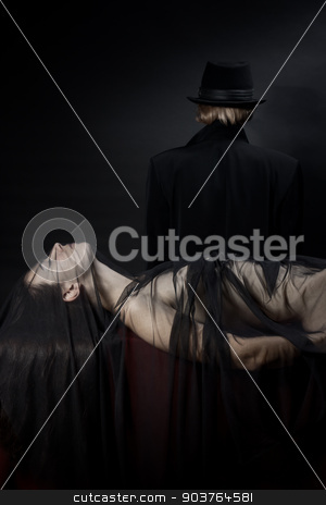 victim of a vampire stock photo, beautiful young nude girl lying on the red fabric, covered with a light black cloth. In the background is the person in a black hat and cloak. by Suchota