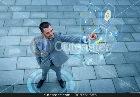 smiling businessman with virtual screens outdoors stock photo, business, development, technology and people and concept - young smiling businessman pointing finger to virtual screens with graphs outdoors from top by Syda Productions