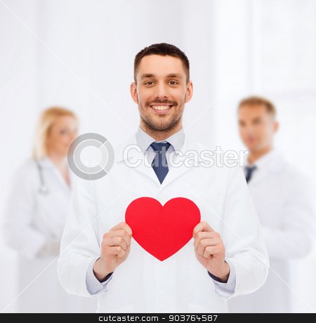 smiling male doctor with red heart stock photo, medicine, profession, and healthcare concept - smiling male doctor with red heart by Syda Productions