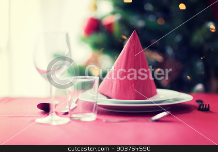 room with christmas tree and decorated table stock photo, holidays, celebration and home concept - close up of room with christmas tree and decorated table by Syda Productions