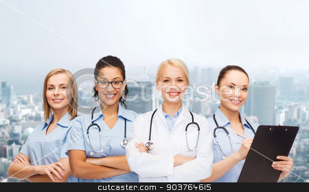team or group of female doctors and nurses stock photo, medicine and healthcare concept - team or group of female doctors and nurses by Syda Productions
