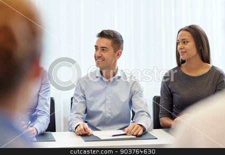 group of smiling businesspeople meeting in office stock photo, business, people and teamwork concept - group of smiling businesspeople meeting on presentation in office by Syda Productions