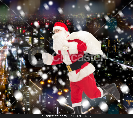 man in costume of santa claus with bag stock photo, christmas, holidays and people concept - man in costume of santa claus running with bag over snowy night city background by Syda Productions
