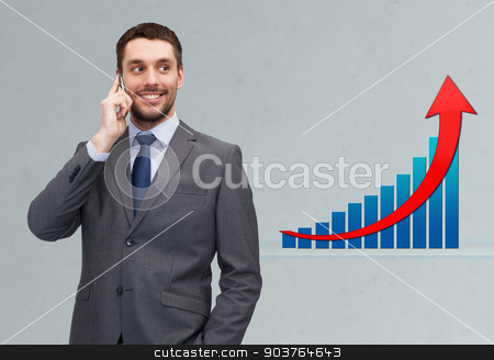 young smiling businessman calling on smartphone stock photo, business, technology, people, success and development concept - young smiling businessman calling on smartphone over gray background and growth chart by Syda Productions