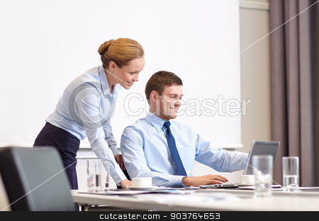 businessman and secretary with laptop in office stock photo, business, people and work concept - businessman and secretary with laptop working in office by Syda Productions