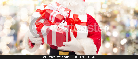 close up of santa claus with gift box stock photo, christmas, holidays and people concept - close up of santa claus with gift box over lights background by Syda Productions