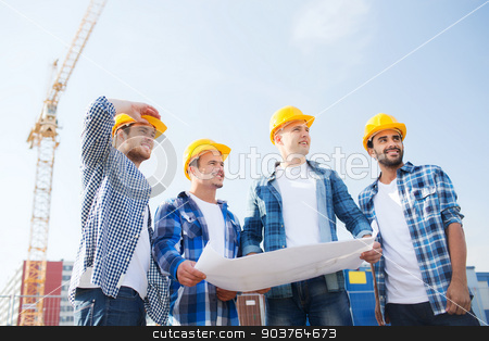 group of builders with tablet pc and blueprint stock photo, business, building, teamwork and people concept - group of smiling builders in hardhats with blueprint outdoors by Syda Productions