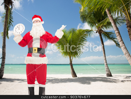 man in costume of santa claus with clock stock photo, christmas, holidays, travel and people concept - man in costume of santa claus with clock showing twelve over tropical beach background by Syda Productions