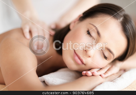 beautiful woman in spa salon getting massage stock photo, health, beauty, resort and relaxation concept - beautiful woman with closed eyes in spa salon getting massage by Syda Productions