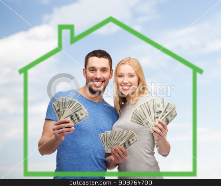 smiling couple holding money over green house stock photo, love, home, people and family concept - smiling couple holding dollar cash money over green house and blue sky background by Syda Productions