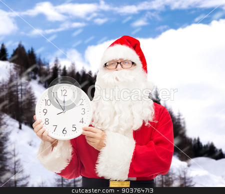 man in costume of santa claus with clock stock photo, christmas, holidays and people concept - man in costume of santa claus with clock showing twelve over snowy mountains background by Syda Productions